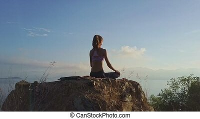 Flycam Shows Backside View Woman Sits in Padmasana - flycam...