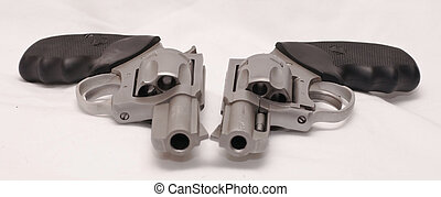 Stainless revolvers - Side by side, two stainless revolvers,...