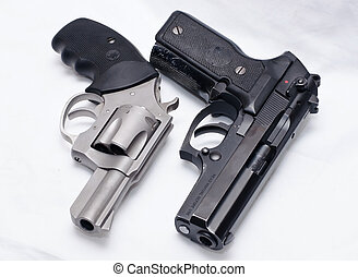 Stainless revolver, black pistol - Side by side, stainless...