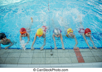 Instructor and group of children doing exercises near a...