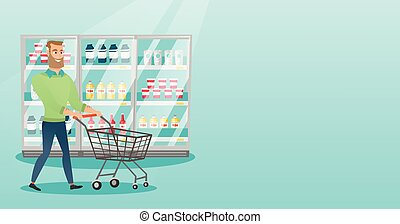 Young caucasian man with supermarket trolley. - Young...