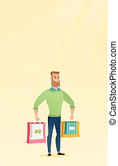 Young happy caucasian man with shopping bags. - Young...