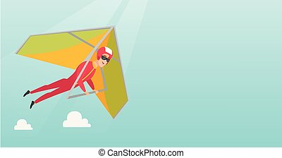 Young caucasian man flying on hang-glider. Sportsman taking...