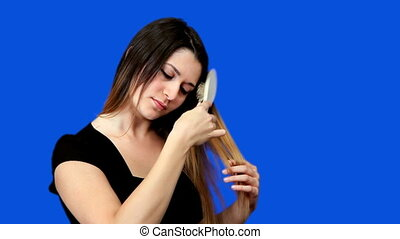 Blue screen beautiful girl comb hair