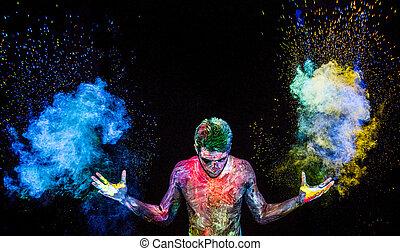 Man throwing up glowing powder - Man throwing up magical...