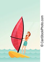 Young caucasian woman windsurfing in the sea. Woman standing...
