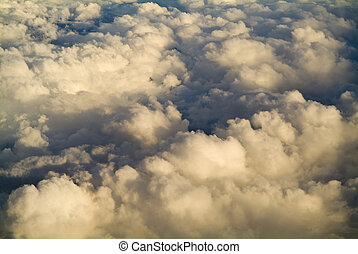 Golden Clouds - High above the clouds with beautiful golden...