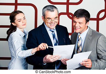 Giving advice - Portrait of happy businessmen looking into...