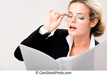Reading papers - Portrait of smart businesswoman in glasses...