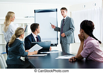 Seminar - Image of smart business people looking at their...