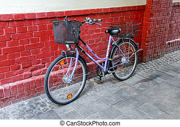 Bicycle parked by the brick wall in Wiesbaden, Hesse,...