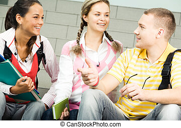 Chatting - Image of three attractive students chatting...