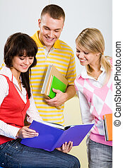 Reading task - Portrait of smart students looking at...
