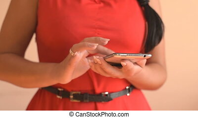 Woman using smartphone. Woman typing text on smartphone....