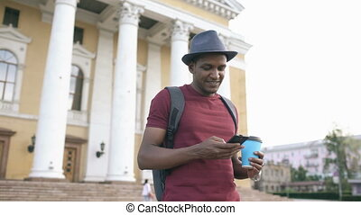 Steadicam shot of smiling tourist man browsing his...