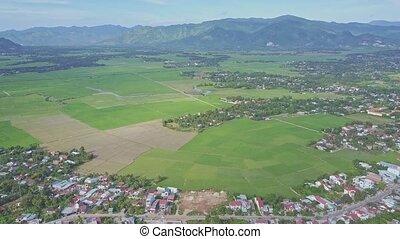 Upper Aerial View Villages around Rice Fields against Hills...