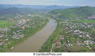 Panoramic View River between Villages against Hills Blue Sky...
