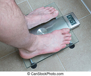 Man's feet on weight scale - OMG