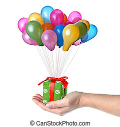 Hand holding gift with color balloons isolated on white