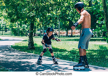 Grandfather and grandson spending quality time, roller...