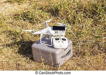 Equipment for driving an unmanned aerial vehicle with a mobile phone and remote control in the field