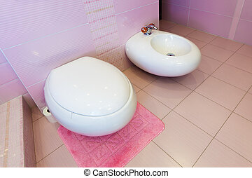 WC and bidet in a beautiful pink bathroom