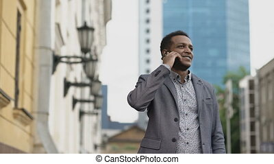 Mixed race businessman calling mobile phone outdoors - Mixed...