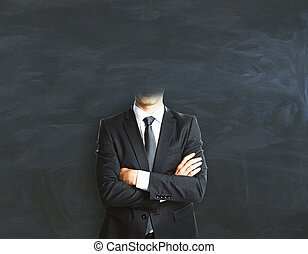 Headless businessman on chalkboard background - Abstract...