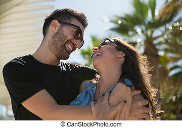 Young happy couple cuddling and laughing together