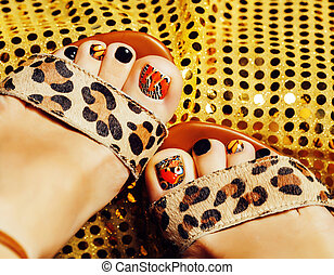 photo of pedicure like butterfly design on gold background...