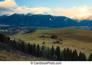 Foothills in Tatra Mountains, Slovakia, with snowy peaks.