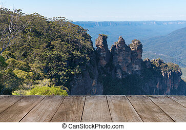 Empty wooden table in front of Jamison Valley and Three...