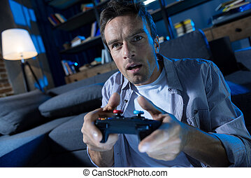 Focused charismatic man obsessed with video games -...