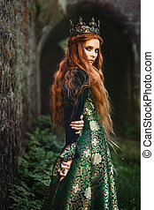 Ginger queen near the castle - Red-haired woman in a green...