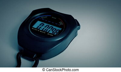 Stopwatch Counts To 10 - Stopwatch on plain white background...