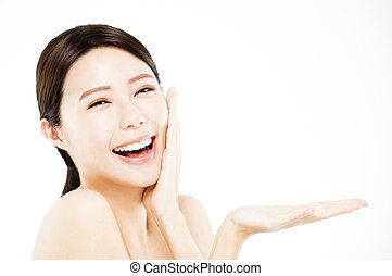 happy Beauty woman showing  beauty product on her hand