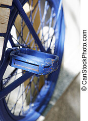 Blue old bicycle pedal in the summer