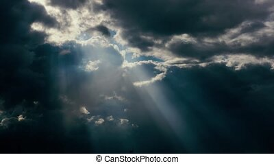 The sun's rays shine through the clouds - Sun rays through...