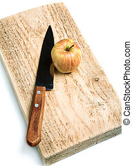 Knife and an apple on a cutting board isolated