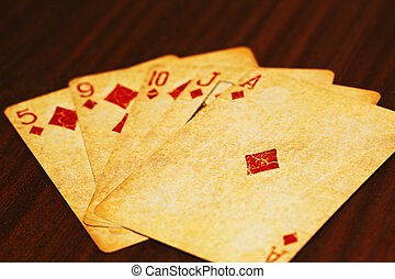 Poker playing cards on the table - Five poker cards in a...