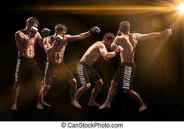 Male boxer boxing in punching bag with dramatic edgy...