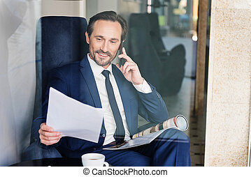 Confident male manager talking on mobile phone - Portrait of...