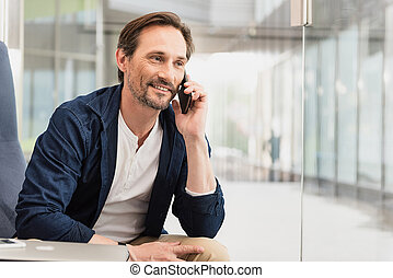 Glad businessman talking on mobile - Portrait of cheerful...