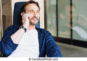Positive businessman communicating on cellphone - Portrait...