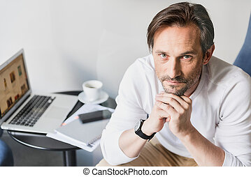 Pensive man using laptop for work - Portrait of serious...