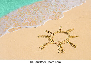 Drawing sun on beach