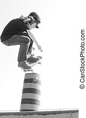 skateboarder in action jumping pylon in flyout