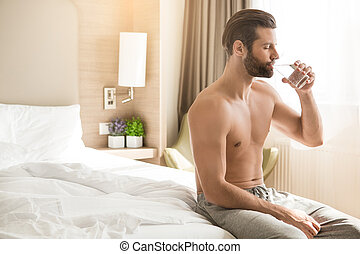 Young man business traveler hotel room accomodation