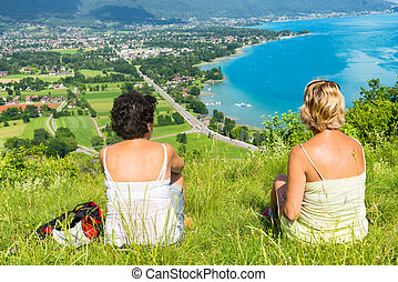 Two women watching view of Lake Annecy - Two women watching...