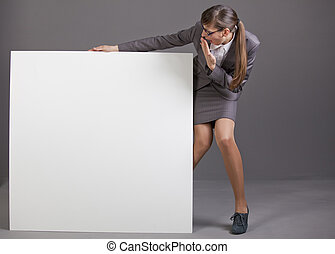 surprised woman with blank board